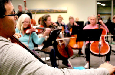 Cellist Elgee Leung rehearses with other members of Marlborough Civic Orchestra ahead of Saturday's performance. Photo: Simon Clark.