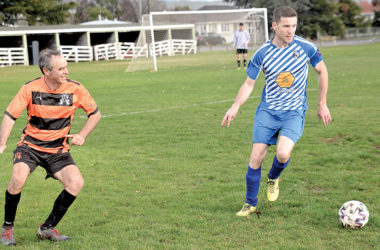 Central Privateers player Gareth Shawcross shields the ball from Call Care Spartans defender John Rawcliffe during their division two match at A and P Park on Saturday. Photo: Peter Jones.