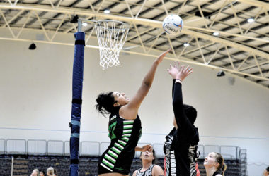 SMOG defender Lina Pale rises high to attempt to block the shot of Tokomaru's Haze Tepuia at Stadium 2000 on Tuesday. Photo: Peter Jones.