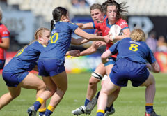 Halfback Pippa Andrews battles with the Otago defence. Photo: Shuttersport.