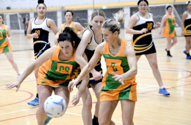 Awatere players Aimee Jones, left, and Kim Andrews shut out MGC defender Taryn Breen at the circle edge.