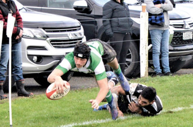 Renwick winger Josh Thomas dives in at the corner for the second of his three tries against Moutere on Saturday. Photo: Peter Jones.
