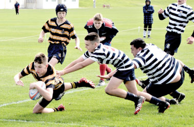 MBC centre Carter Aitken dots down against Otago BHS on Wednesday. Photo: Peter Jones.