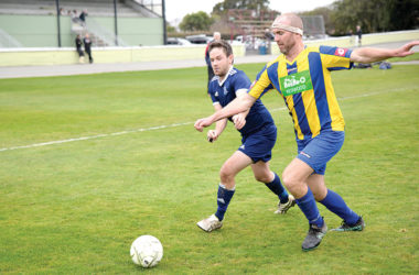 Central Wolves forward Sam Boyce, left, and BV Masters defender Aaron Vercoe contest possession at Athletic Park. Photo: Peter Jones.