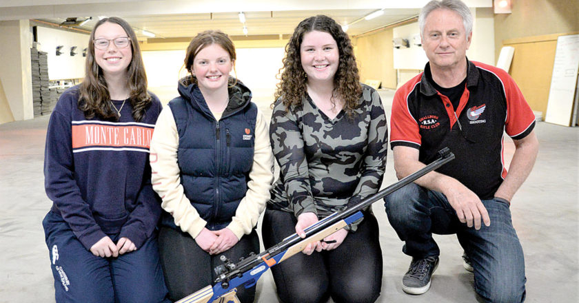 Val Wadsworth, right, with the Marlborough Girls' College shooting team. From left, Issy Adams, Sara Wiblin and Sophia Wills. Photo: Peter Jones.
