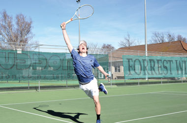 Marlborough player Oscar Parkinson reaches high to attempt a forehand return during his doubles match with brother Felix against Joe Yank and Will Poff last weekend. Photo: Peter Jones.