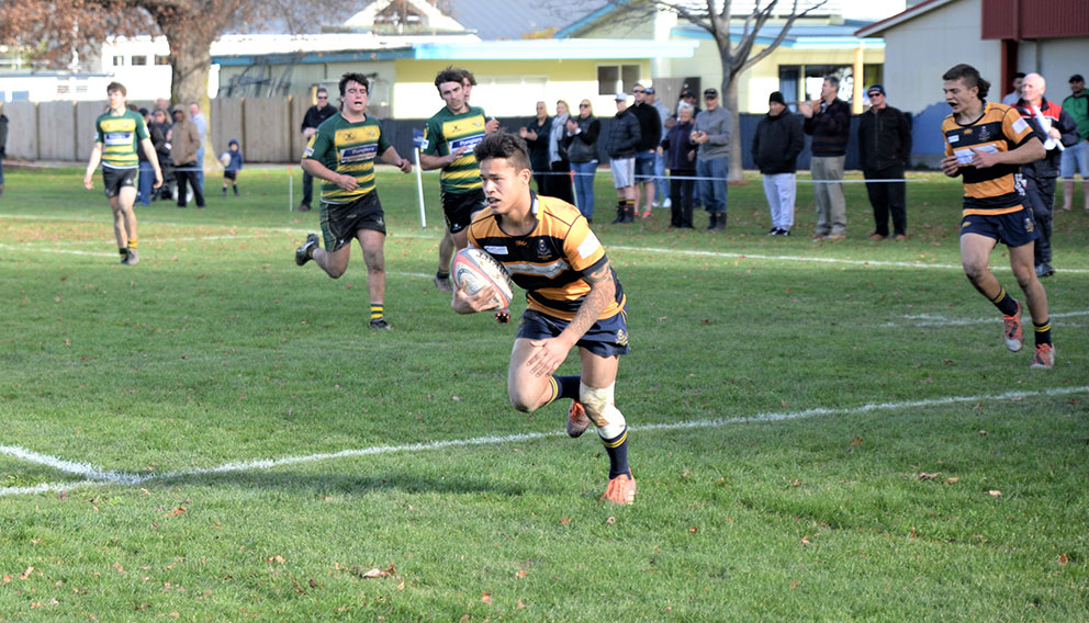 MBC First XV replacement winger Dartell Rarere crosses for a late consolation try on Saturday. Photo: Peter Jones.