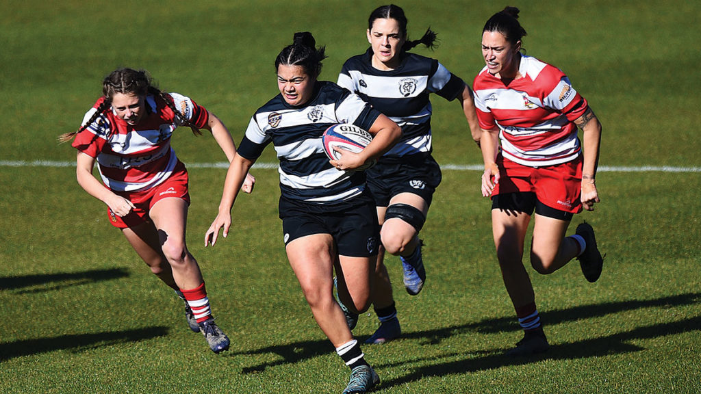 Moutere player Leti Fotumoala carries the ball strongly in Saturday's final at Traflagar Park. In support is Alexa Fraser. Photo: Shuttersport.