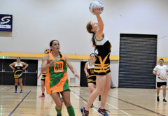 MGC midcourt player Ella Donald rises high to haul in a pass during Tuesday's thriller with Awatere. Photo: Peter Jones.