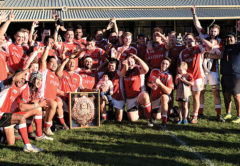 The 2018 Tasman Red Devils celebrate getting their hands on the coveted Seddon Shield. Photo: Peter Jones.