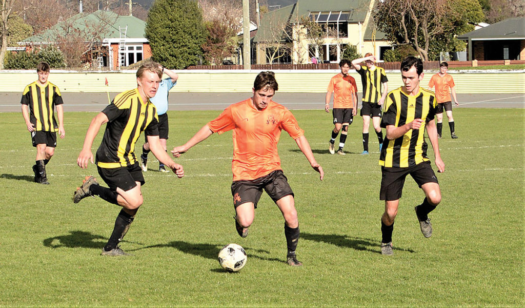 Call Care Trojans midfielder Brayden Livingstone finds a path through the Novus Picton defence at Athletic Park on Saturday. Photo: Peter Jones.