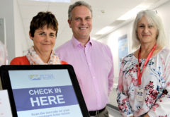 Change manager Sue Lawrence, project manager Grant Pownall and clinical support staff member Lisa Naeyaert with 'Florence'. Photo: Paula Hulburt.