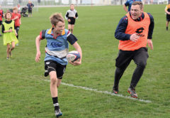 Youngster Tom Robinson endeavours to escape the clutches of Mako loose forward Braden Stewart. Photo: Peter Jones.