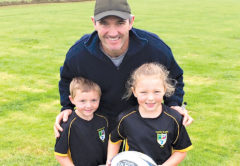 """Chatham Islands rugby players Charlie, 6, and Bella Bromwich, 8, meet with All Blacks legend Stephen """"Beaver"""" Donald during his visit to the Islands earlier this year. Photo: Supplied."""