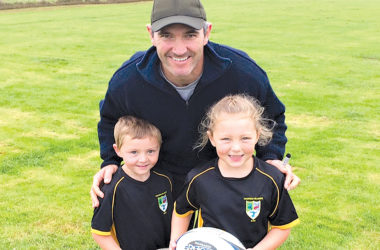 "Chatham Islands rugby players Charlie, 6, and Bella Bromwich, 8, meet with All Blacks legend Stephen ""Beaver"" Donald during his visit to the Islands earlier this year. Photo: Supplied."