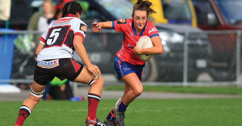 Tasman halfback Pippa Andrews attempts to shrug out of a North Harbour tackle on Saturday. Photo: Shuttersport.