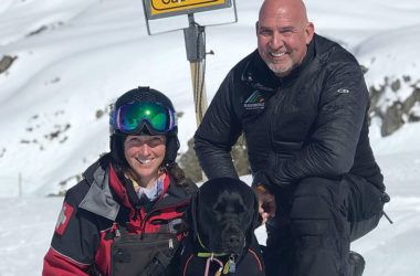 Avalanche dog handler Cait Hall with Rosko and Rainbow Ski Area's general manager James Lazor. Photo: Charles Anderson.