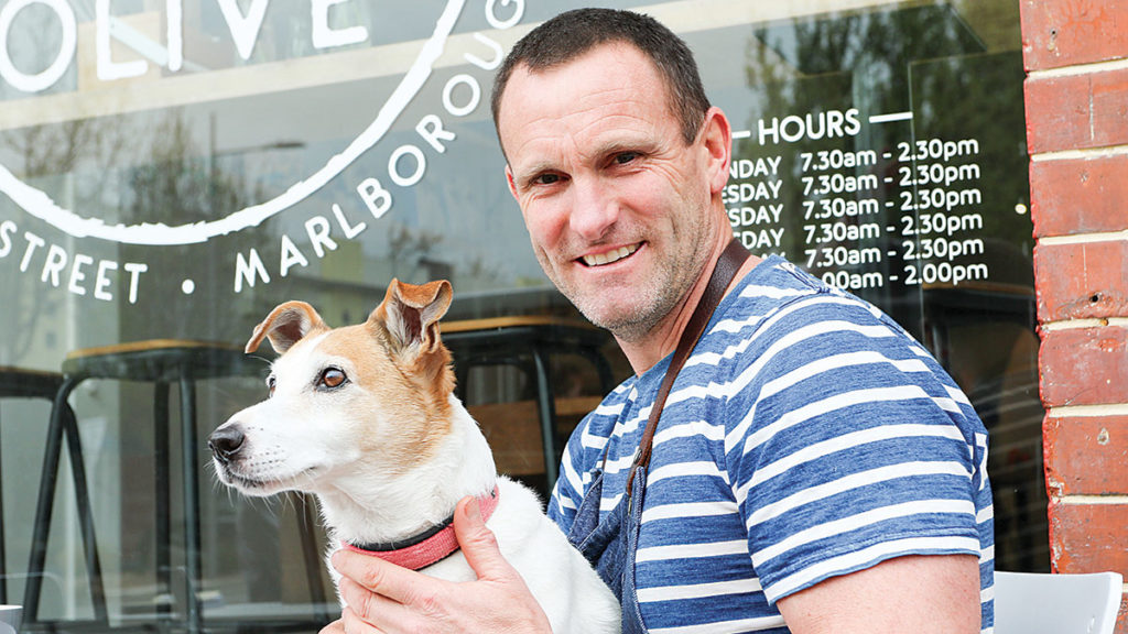Café Herb and Olive owner Richard Barton with 10-year-old fox terrier Pepe. Photo: Paula Hulburt.