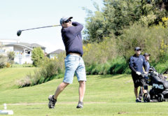 Grant Craig, from the Heagney Bros team, puts everything into this drive off the second tee. Photo: Peter Jones.