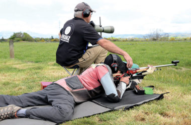 Kaituna wind coach Malcolm Dodson adjusts the setting on junior shooter Clinton Whyte's rifle during Monday's team shoot. Photo: Peter Jones.