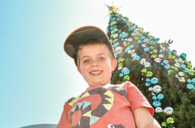 "Charlie Chambers, 5, ""loves"" the massive Christmas tree in the Blenheim town centre, especially the ""big, giant sparkly star"". Photo: Matt Brown."