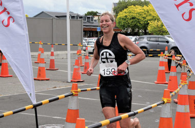 Emily Marfell runs down the finishing chute to claim her first victory in the Sisters Marlborough Women's Triathlon. Photo: Peter Jones.