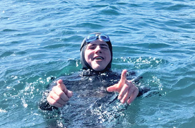 MBC student George Glover training in the Sounds for his fund-raising swim later this year. Photo: Supplied.