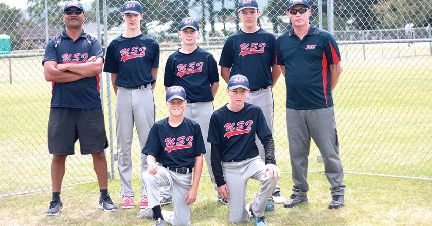 The five Marlborough-based players in the under-15 boys Upper South Island softball team, with coaches Darren Aldridge and Marshall Rawiri. Photo: Supplied.