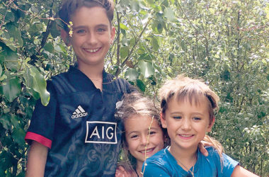 Manaia Huntly, left with sister Tui and brother Taika, is celebrating being disease free. Photo: Supplied.