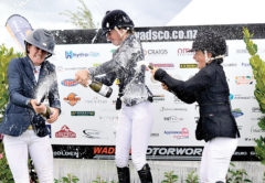 It's fun on the podium as Grand Prix place-getters, Lucinda Askin, Tegan Fitzsimon and Heloise Tolo let loose with the champagne. Photo: Peter Jones.