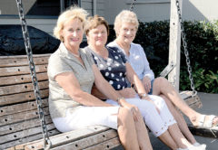 Three members of the original Allan Scott Family Wines Marlborough Golf tournament organising committee, from left, Jo Grigg, Ann Rutledge and Mary-Ann Jacobson, relax on a swing seat, donated to the club by a former member, the late Shirley Startup, who won it by scoring a hole-in-one during the tournament. Photo: Peter Jones.