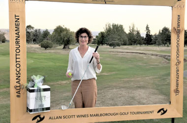 Julie Smith with the club and ball she used to register an ace at the Allan Scott tournament. Photo: Supplied.