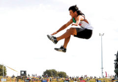 Nikau Peipi soars into the long jump pit at the recent New Zealand Track and Field champs. Photo: Alisha Lovrich Photography.