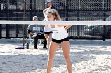 Eloise van Velthooven waits at the net during an inter-collegiate beach volleyball match. Photo: Supplied.