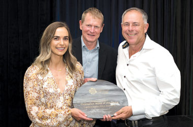 Daughter Emma Marris, and Father Brent Marris accept the 2020 Marlborough Wine Show, Champion Wine of the Show Trophy from Hugh Morrison. Photo: Richard Briggs.