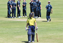 The Wairau players gather together at the fall of Bailey Andrews-Kennedy's wicket. Photo: Peter Jones.