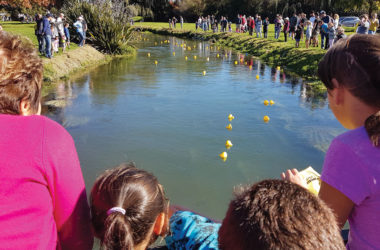 The popular Taylor River has a myriad of uses besides swimming, like the Five Buck a Duck Derby. File photo.