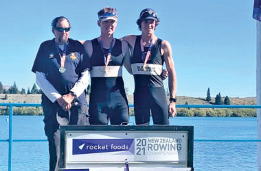 The victorious Blenheim RC club pair of Fred Vavasour and Dylan Burton share the podium with coach John Robinson. Photo: Supplied.