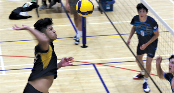 MBC Gold player Jared Moli rises high for a spike during Sunday's final. Photo: Peter Jones.